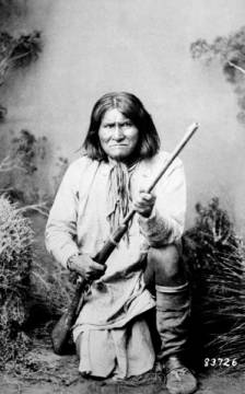 Geronimo holding a rifle, 1884 of artist American Photographer as framed image