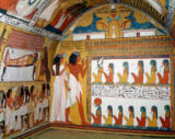 Egyptian 19th Dynasty - Sennedjem and his wife facing a naos containing twelve divinities, from the west wall of the Tomb of Sennedjem, The Workers' Vil