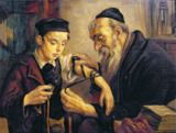 Jewish school - A Rabbi tying the Phylacteries to the arm of a boy