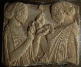 Greek School - The Stele of Pharsalos depicting the glorifying of the flower, two girls face to face carrying flowers and purses, c.460 BC