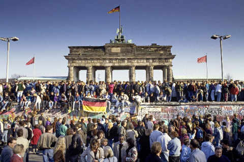 Fall of the Berlin Wall: people from East and West Berlin climbing on the Wall at the Brandenburg Gate, Berlin, Germany of artist Norbert Michalke (F1 Online) as framed image