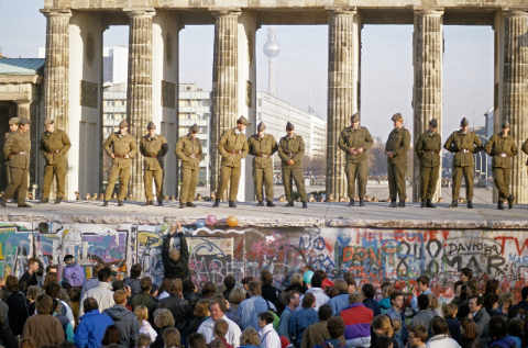 Fall of the Berlin Wall: Soldiers saving the wall at the Brandenburg Gate, Berlin, Germany of artist Norbert Michalke (F1 Online) as framed image
