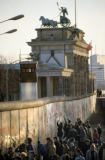Norbert Michalke (F1 Online) - Fall of the Berlin Wall: people chiselling pieces off the Wall at the Brandenburg Gate, Berlin, Germany
