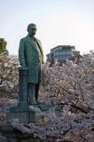 S. Tauqueur (F1 Online) - Statue in a park surrounded by cherry trees,Tokyo, Japan
