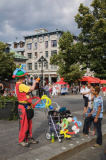 First Light (F1 Online) - Street performer entertaining tourists at Place Jacques Cartier in Old Montreal in summertime, Quebec, Canada