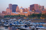 First Light (F1 Online) - Old Montreal skyline and the yacht marina in the Old Port of Montreal at sunrise, Quebec, Canada
