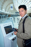 First Light (F1 Online) - Businessman using express check in at airport, Toronto, Canada