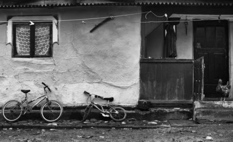 Two bicycles,a boy and a chicken of artist Julien Oncete, Mud, Boy, Poverty, Chicken, Oldhouse, Bicycles, Documentary, Momaiatigveniarges