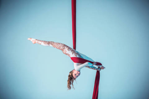 Graceful gymnast performing aerial exercise of artist Volodymyr Melnyk as framed image