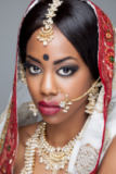 Tomas Anderson - Young Indian woman in traditional clothing with bridal makeup and jewelry