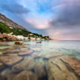 Andrey Omelyanchuk - Rainbow over Rocky Beach and Small Village after the Rain, Dalmatia, Croatia