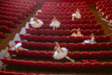 Volodymyr Melnyk - Ballerinas sitting in the empty auditorium theater