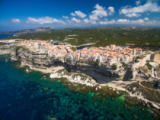 Viktor Cap - Aerial view the Old Town of Bonifacio, the limestone cliff, South Coast of Corsica Island, France