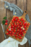 Volodymyr Melnyk - Fresh strawberry fruits, flowers, leaves on white wood table background