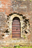 Alena Dvorakova - Old wooden door in aged brick wall
