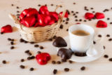 Luigi Morbidelli - Red chocolate hearts in a small basket and an espresso coffee