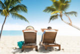 Andriy Popov - Couple relaxing on deck chairs at beach resort